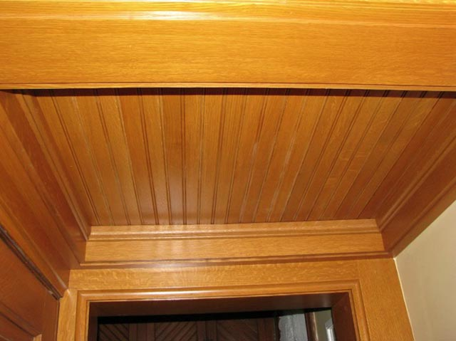 Custom milled quarter-sawn oak ceiling.