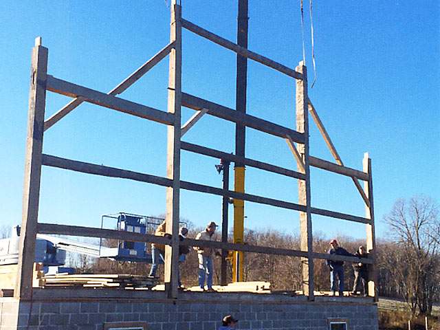Setting the first truss on new barn
