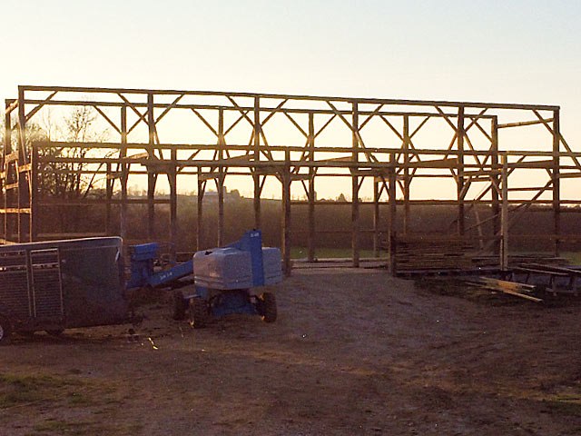 Raised barn trusses at dusk
