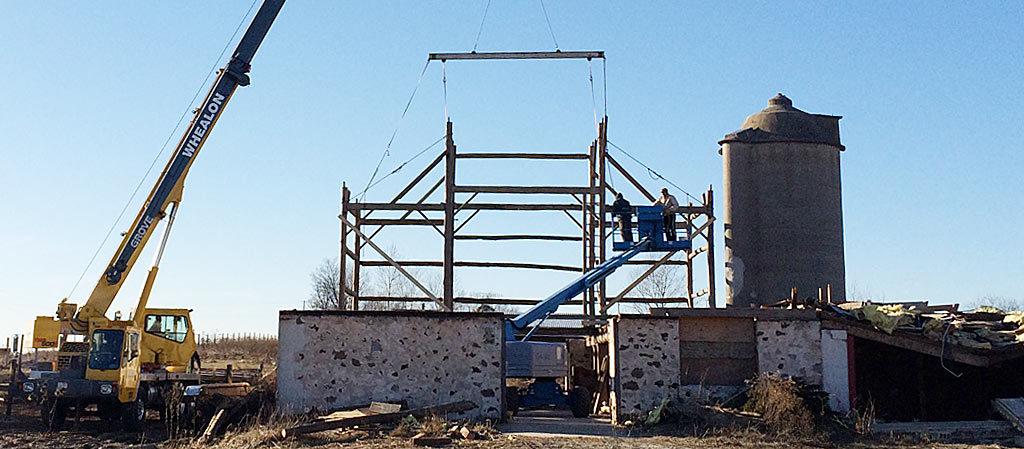 Dismantling the old barn.