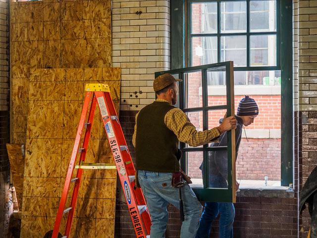 John and Jimmy Installing New Window